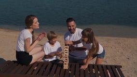 Positive family play jenga game stock footage