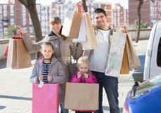 Positive family portrait with purchases in bags Stock Photos