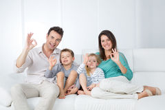 Positive family sitting on sofa Royalty Free Stock Photo