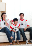 Positive family watching football match Royalty Free Stock Image