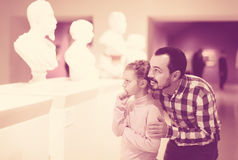 Positive father and daughter exploring statues Royalty Free Stock Photography