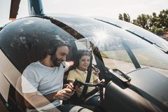 Positive father and glad child controlling helicopter stock photos