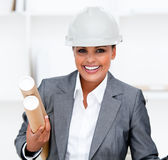 Positive female architect holding blueprints. Portrait of a Positive female architect holding blueprints Stock Image
