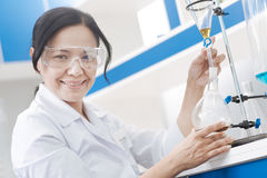 Positive female biochemist working in the lab Royalty Free Stock Photo