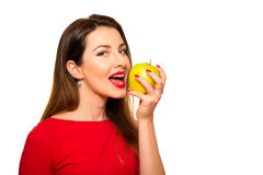 Positive Female Biting a Big Green Apple Fruit Smiling on White Royalty Free Stock Photography