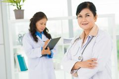 Positive female doctor Stock Image