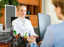 Positive female doctor discharging patient Royalty Free Stock Images