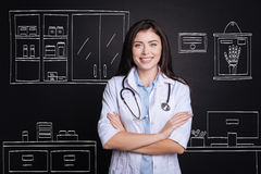 Positive female doctor standing in the hospital Royalty Free Stock Photography