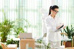 Positive female entrepreneur preparing for opening of own restau stock image