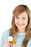 Positive female patient holding pills and smiling Royalty Free Stock Image