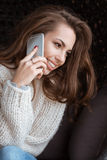Positive female talking on cell phone and smile. Positive beautiful female talking on cell phone and smile Stock Image