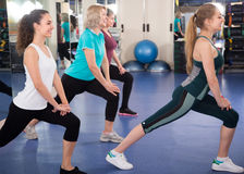 Positive females having gymnastic class. In fitness club stock photography