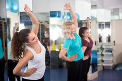 Positive females having gymnastic class Royalty Free Stock Images