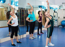Positive females working out at aerobic class in modern gym Royalty Free Stock Photos
