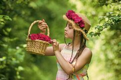 Free Positive Florist Holding Flowerpot. Flower Composition. Beautiful Girl In Straw Hat Collect Roses. Happy Childhood Royalty Free Stock Image - 200345856