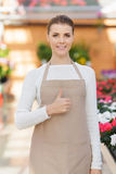 Positive flower seller at work Royalty Free Stock Photo