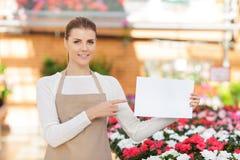 Positive flower seller at work Stock Photo