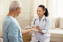 Positive friendly doctor cheering up her patient Royalty Free Stock Image