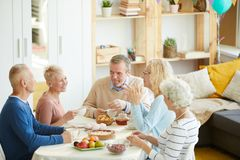 Positive friends chatting at table royalty free stock photos