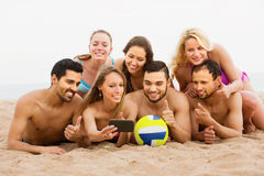 Positive friends of different age doing selfie Stock Photos
