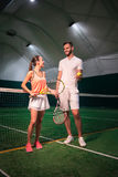 Positive friends going to play tennis Royalty Free Stock Photo