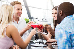 Positive friends sitting in the cafe Stock Images