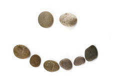 Positive funny emoticon assembled of pebble Royalty Free Stock Photography