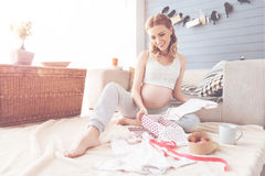 Positive future mother resting at home Royalty Free Stock Photography