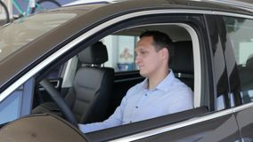 Positive gesture of consumer, car keys In hands of men, delight. Male on new automobile, happy client in slow motion, portrait of male in vehicle, man enjoying stock video footage