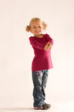Positive girl. Positive thinking blond girl with curly hair and two thumbs up royalty free stock image