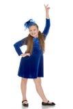 Positive girl in a beautiful velvet dress Stock Image
