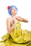 Positive girl with blue hair looks up Stock Images