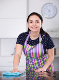 Positive girl cleaning in house Royalty Free Stock Photos