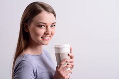 Positive girl drinking coffee Stock Image
