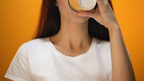 Positive girl drinking coffee, morning charge with energy and good mood, closeup. Stock footage stock footage