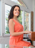 Positive girl having piano class Stock Images