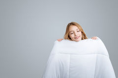 Positive girl holding blanket Royalty Free Stock Images