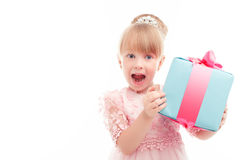 Positive girl holding present box Royalty Free Stock Images