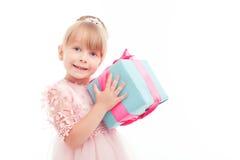 Positive girl holding present box Royalty Free Stock Photos