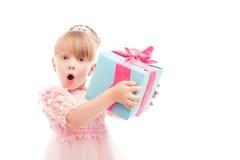 Positive girl holding present box Stock Photos