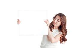 Positive girl holding white board Stock Images