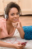 Positive  girl listening to music Stock Photo