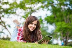 Positive girl lying on the grass royalty free stock photos