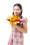 Positive girl with maple leafs Royalty Free Stock Photo