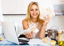 Positive girl with money Stock Image