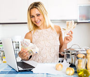 Positive girl with money Royalty Free Stock Image