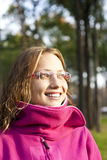Positive girl in a park. eyes. glasses Stock Photo