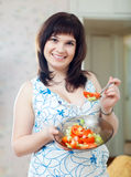 Positive   girl plate of  tomatoes salad Royalty Free Stock Photo
