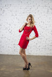 Positive Girl in red party dress Royalty Free Stock Photos