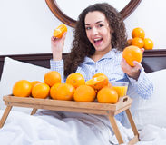 Positive girl with ripe oranges and glass of juice Royalty Free Stock Photos